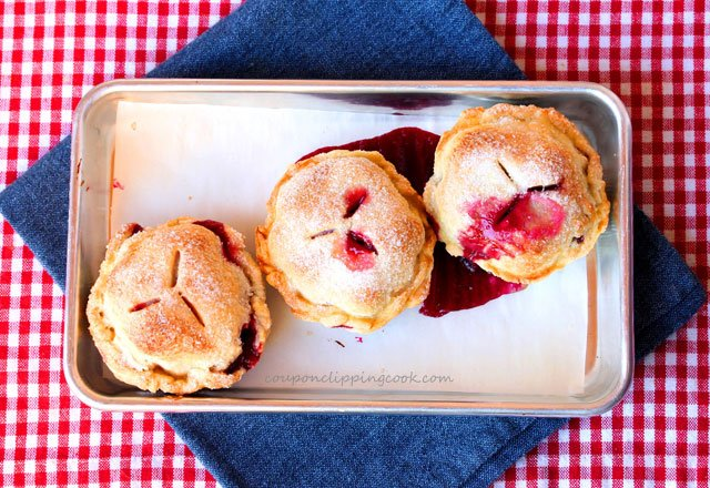Blackberry and Lemon Mason Jar Lid Pies on pan