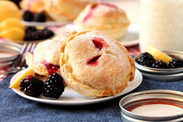 Blackberry and Lemon Mason Jar Lid Pies on plate