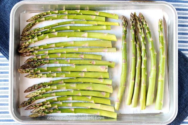Asparagus spears on baking pan