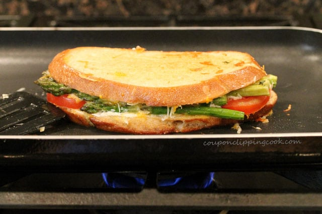 Roasted Asparagus and Tomato Garlic Bread Grilled Cheese on pan