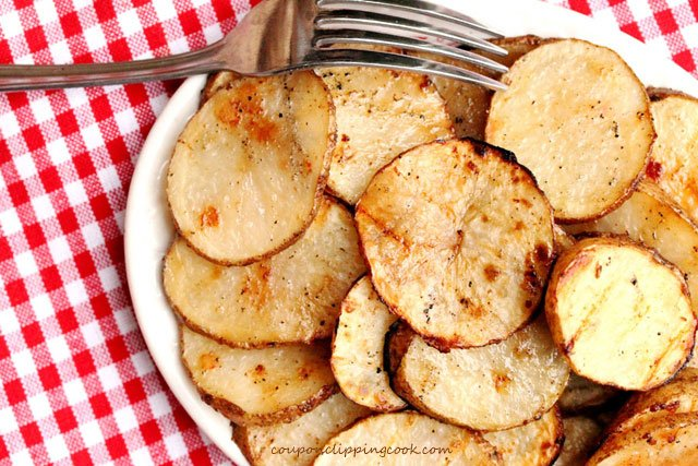 Grilled Potato Slices on plate with fork