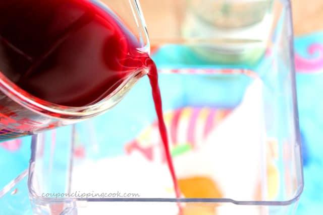 Pour pomegranate juice in blender pitcher