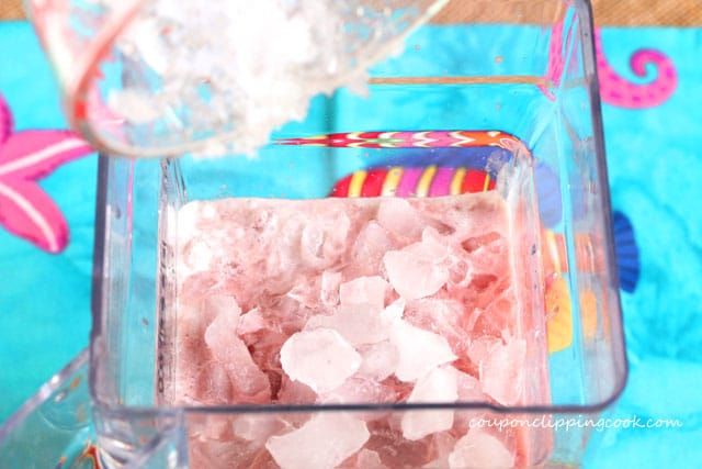 Add crushed ice to blender pitcher