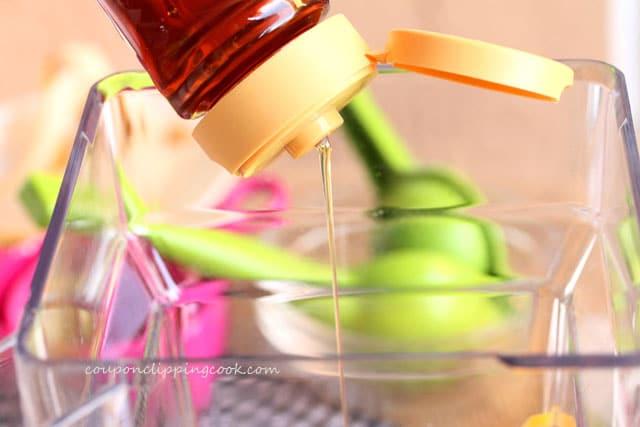 Add honey to blender pitcher