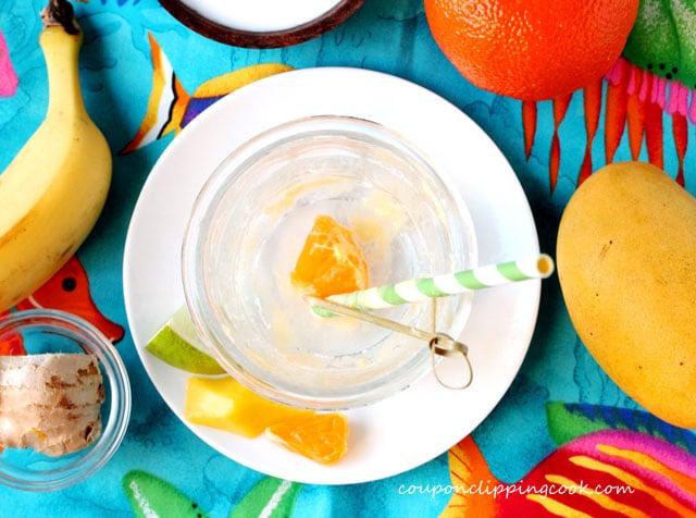 Empty glass with orange and straw