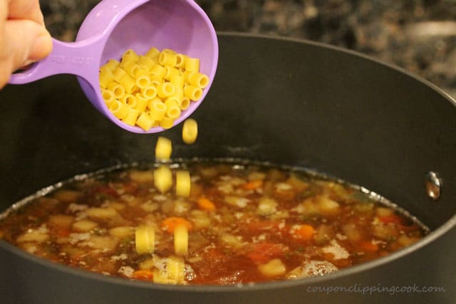 Add pasta to Eggplant Supper Soup with Ground Beef in pot