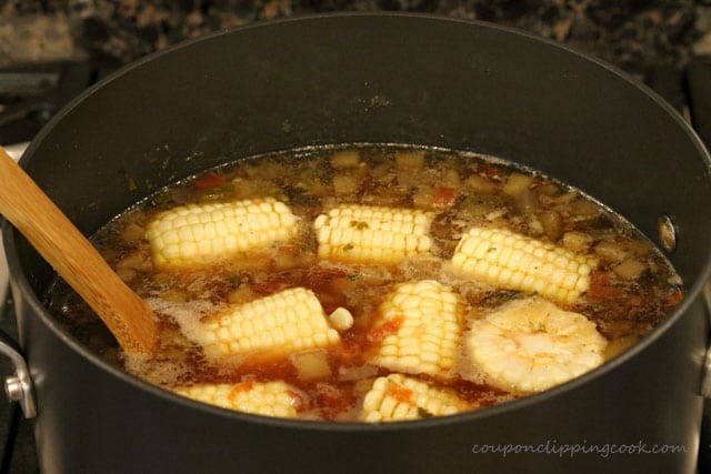 Stir Eggplant Supper Soup and Corn on the Cob in pot
