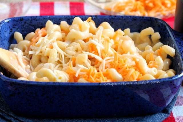 Stir macaroni and cheese in casserole dish