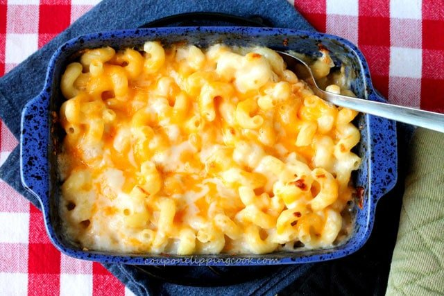 Baked macaroni and cheese in casserole dish with spoon