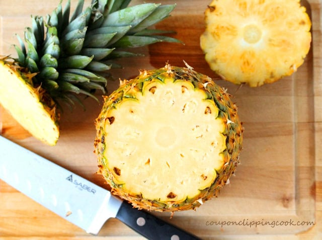 Cut top off of Pineapple on cutting board