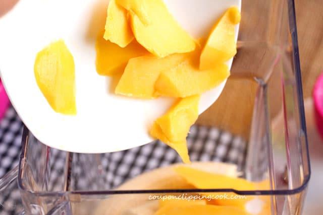 Add mango to blender pitcher