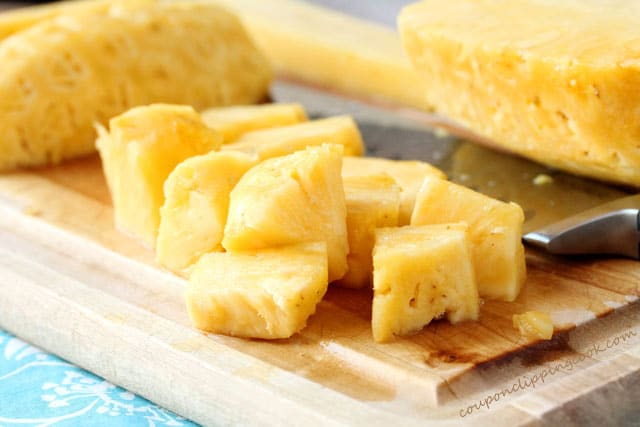 Cut pieces of pineapple on cutting board