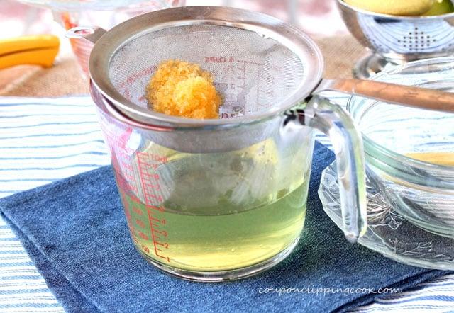 Strained lemon zest in strainer