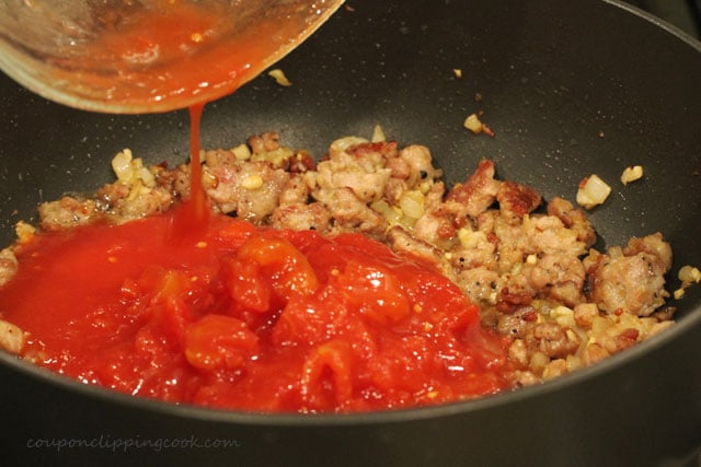 Add cut tomatoes in pan with Italian sausage