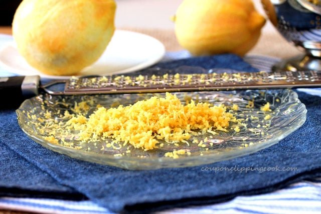 Lemon zest with grater on plate