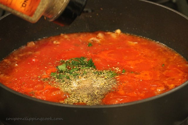Add seasoning to sauce in pot
