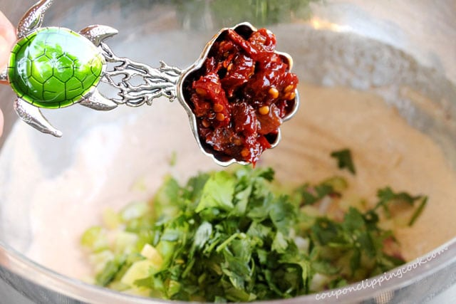 Add chopped chipotle peppers in bowl