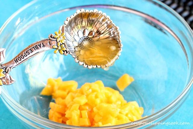 Add fresh orange juice in bowl with mango