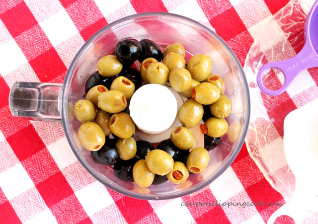 Black and green olives in food processor