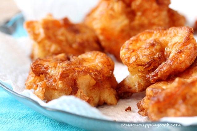 Fried battered shrimp on plate with paper towel