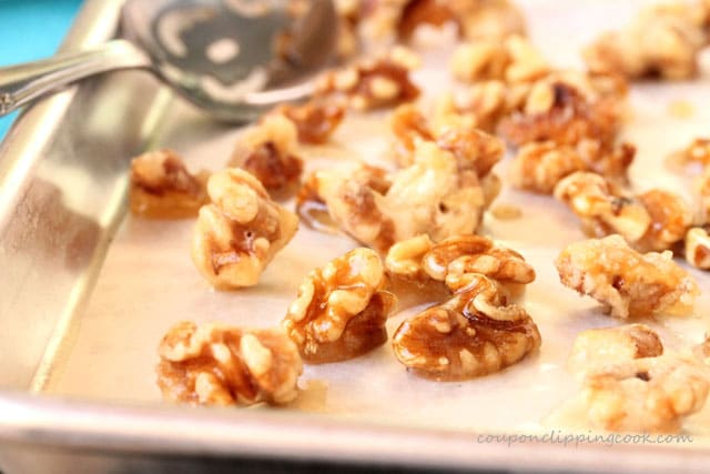 Lay candied walnuts on parchment paper on pan