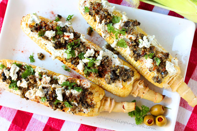 Grilled Corn with Goat Cheese and Olive Tapenade on plate
