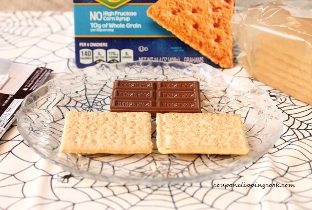 Graham crackers and chocolate bar on plate