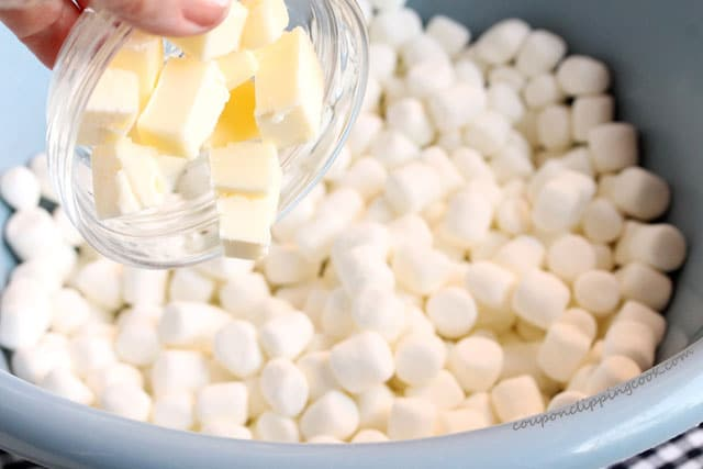 Add butter to marshmallows