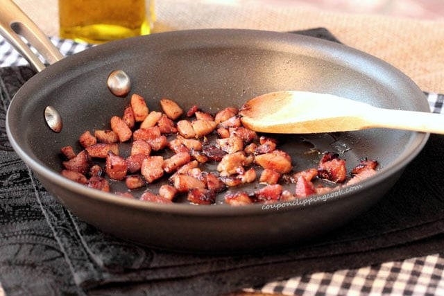 Browned pieces of ham in skillet