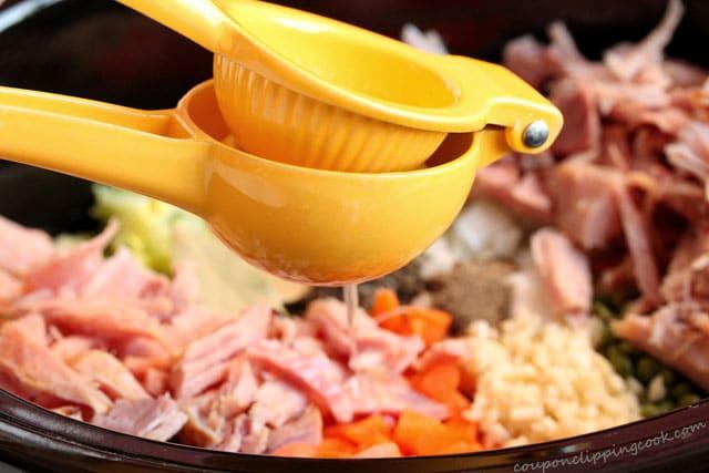 Squeeze lemon juice into soup ingredients