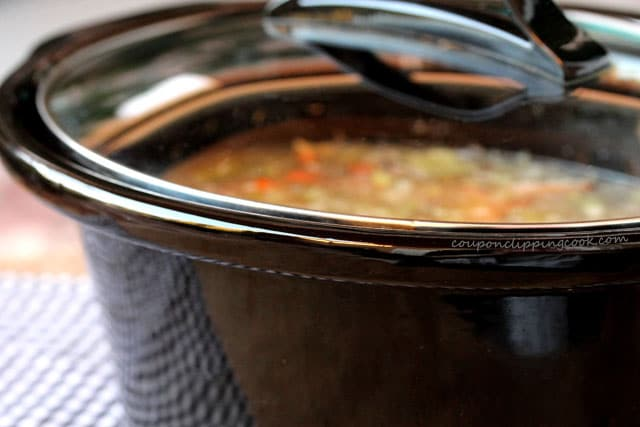 Lid on slow cooker pot with soup
