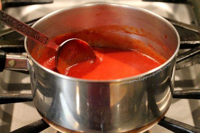 Stir marinara sauce in pot