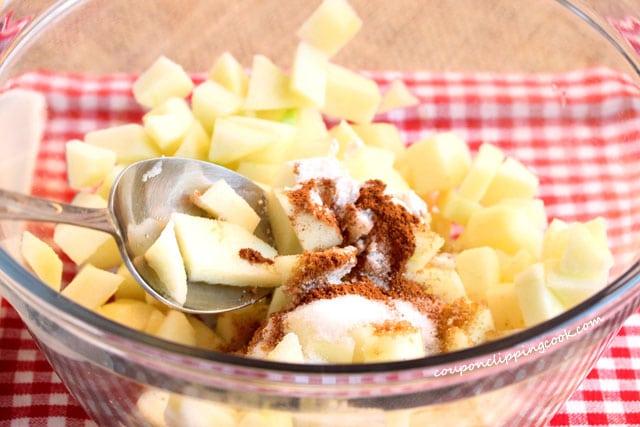 Stir apple pie filling in bowl