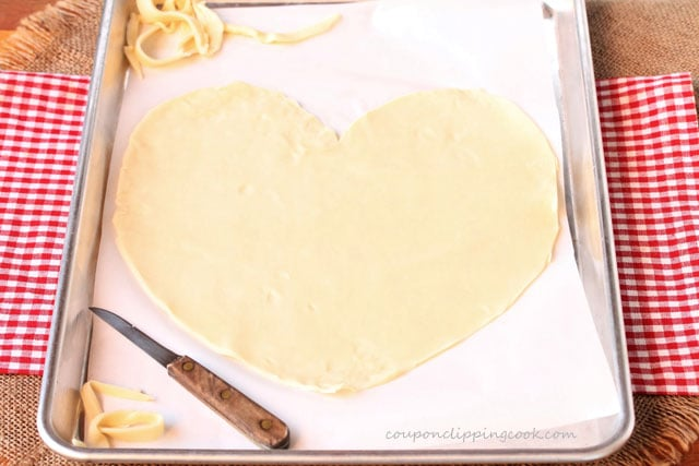 Heart shaped pie dough on pan