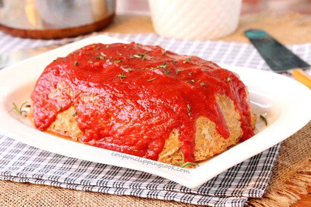 Seasoned tomato sauce on meatloaf on plate