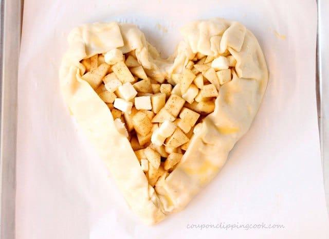 Apple pie filling in heart shaped pie dough