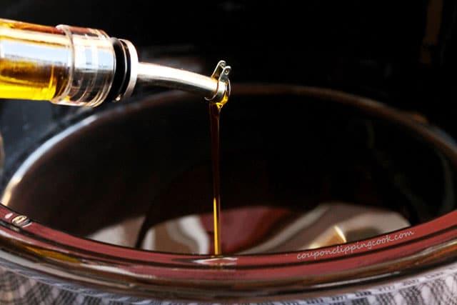 Add olive oil to crockpot