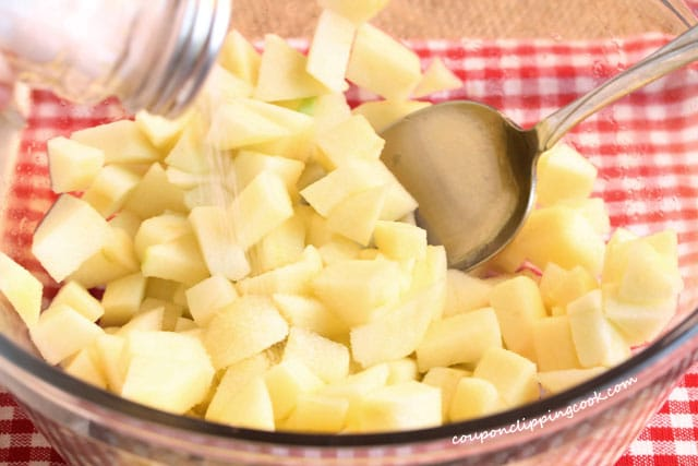 Add salt to chopped apples in bowl