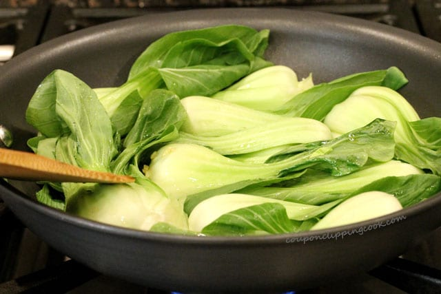 Cook baby bok choy in skillet