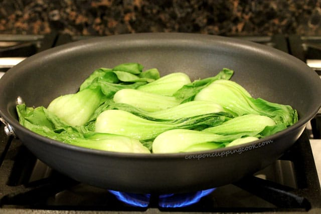 Steamed baby bok choy in pan