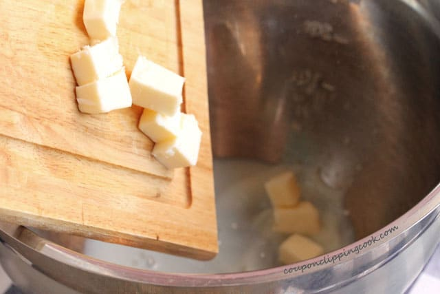 Add cubed butter to mixing bowl