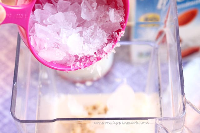 Add crushed ice to blender jar