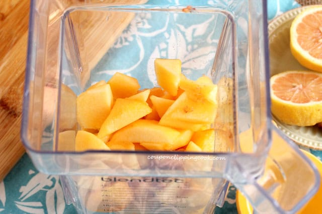 Add cut peaches to blender