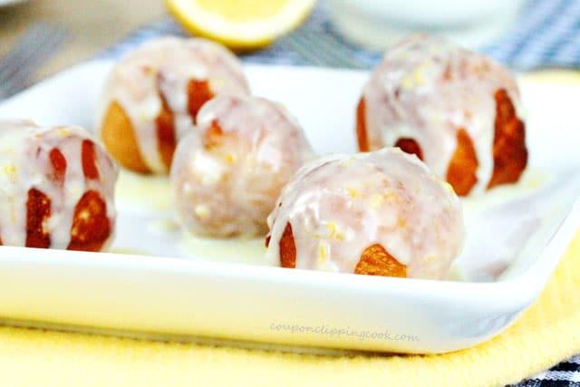Doughnut Balls with Lemon Glaze on plate