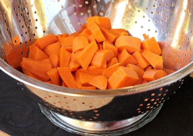 Cut yams in colander