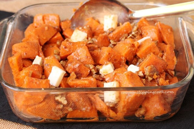 Stir candied yams in dish