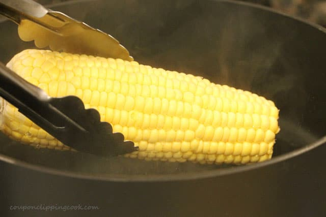 Add ear of corn in hot water in pot