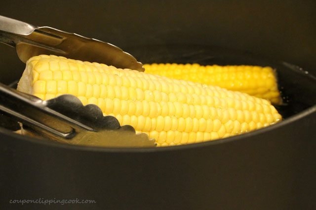 Add ear of corn in water