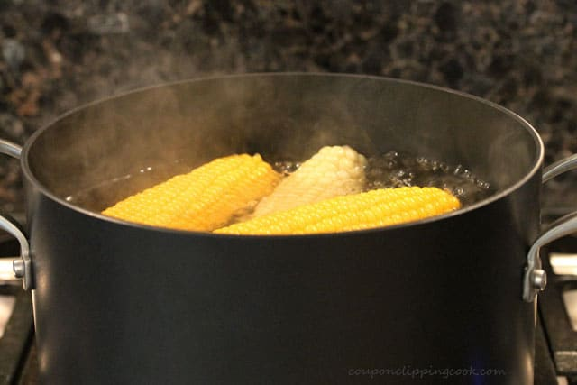 Boiling corn on the cob in pot