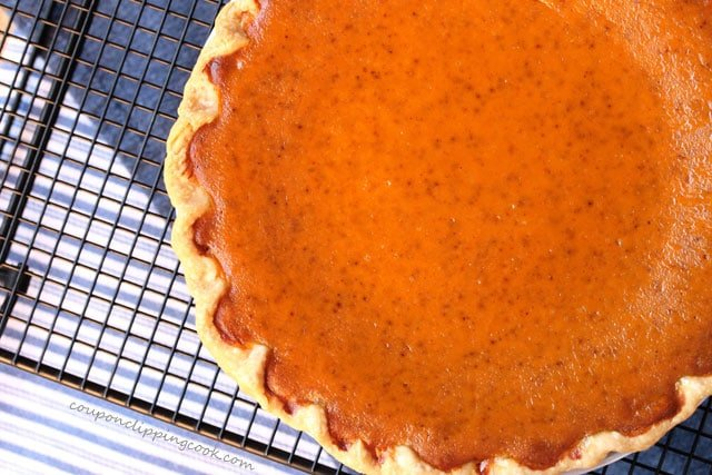 Pumpkin pie on rack